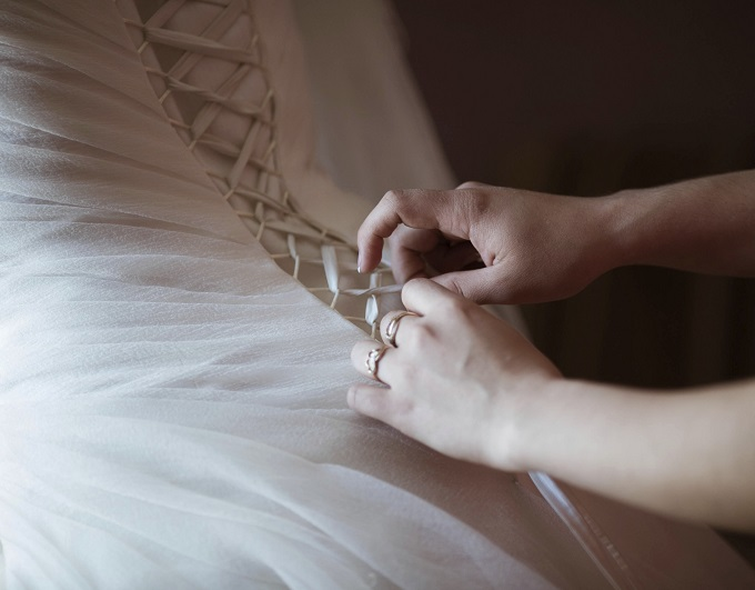 bride dresses a wedding dress